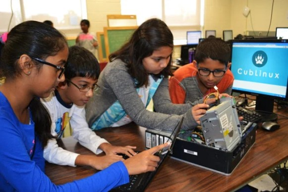 Tech Stewardship students working on a computer