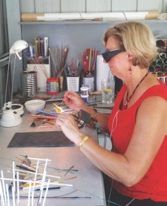 Wendy Hitchins demonstrating glass bead making in her Drouin studio