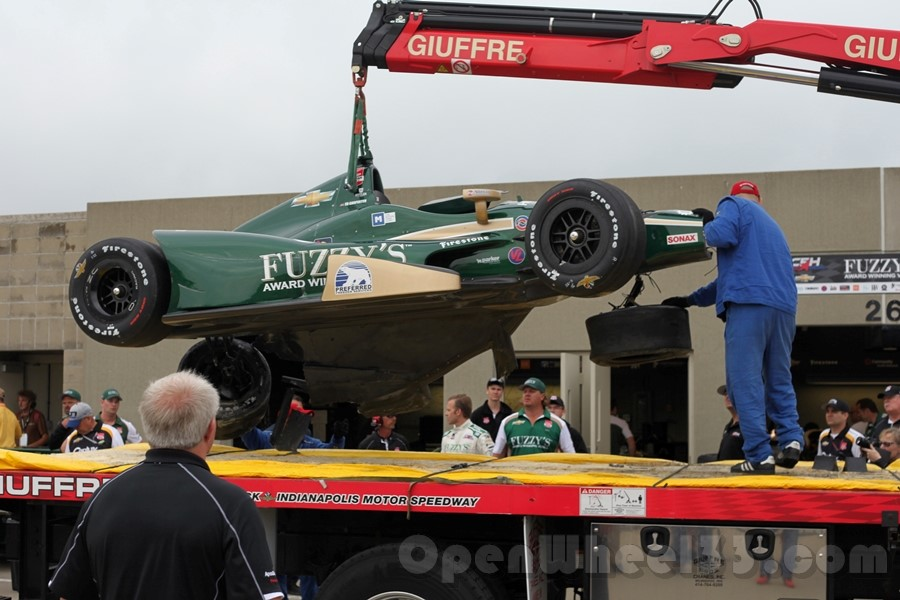 The damaged No. 20 returns to Gasoline Alley