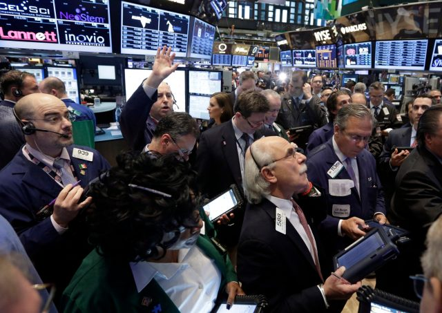 Traders gather at a post on the floor of the New York Stock Exchange Thursday, April 11, 2013.  Stock indexes are little changed in early trading on Wall Street after three days of gains. (AP Photo/Richard Drew)