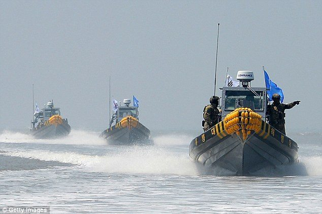 It's alleged that two Chinese boats rammed the 4.5-tonne coastguard vessel (File photo)