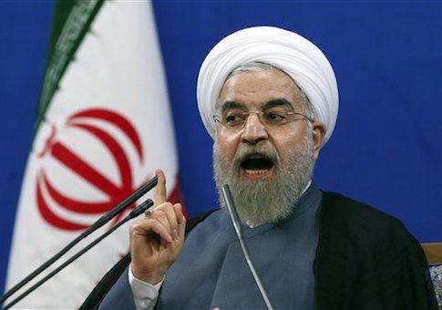 """Iranian President Hassan Rouhani speaks during a press conference on the second anniversary of his election, in Tehran, Iran, Saturday, June 13, 2015. Rouhani said a final nuclear deal is """"within reach"""" as Iran and world powers face a June 30 deadline for an agreement. Rouhani said Iran will allow inspections of its nuclear facilities but vowed that the Islamic republic won't allow its state """"secrets"""" to be jeopardized under the cover of international inspections. (AP Photo/Ebrahim Noroozi)"""