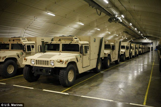 Spacious: Humvees are stored inside the Frigaard Cave in central Norway. The cave is one of six caves that are part of the Marine Corps Prepositioning Program in Norway