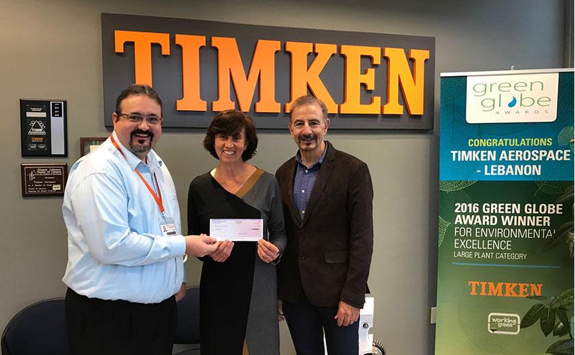 Todd Laquerre, Timken Plant Manager, presents $50,000 check to Opera North's Maria Laskaris, Director of Development, and Louis Burkot, Artistic Director