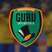 logo do guru do cartola: escudo verde com as laterais laranja escrito guru do cartola e o desenho de um chapéu logo abaixo