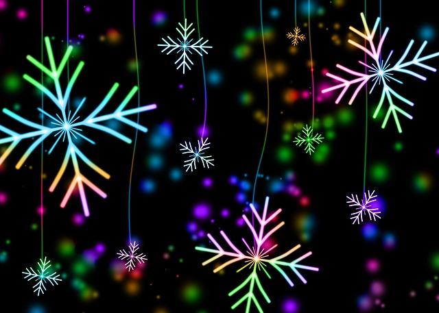 Chute de flocons de neiges stylisés multicolores.