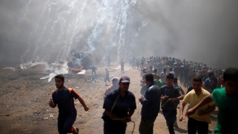 الاحتلال يواجه مليونية سلمية بمجزرة وعباس يشدد على النضال حتى إقامة الدولة المستقلة