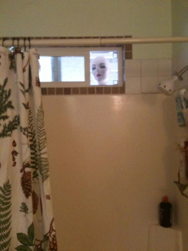 Place a mannequin head at your bathroom's window.