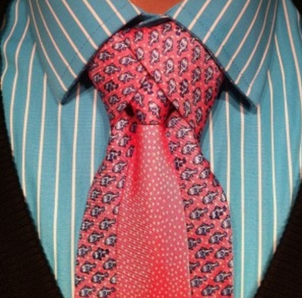 The Ediety became popular when fans first spotted in The Matrix Reloaded. It was worn by the character Merovingian. Essentially, it's a tie within a tie.