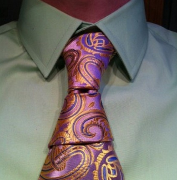 The Krasny hourglass is two full knots. You may want to wear it with a vest to conceal the shorter length of the tie.