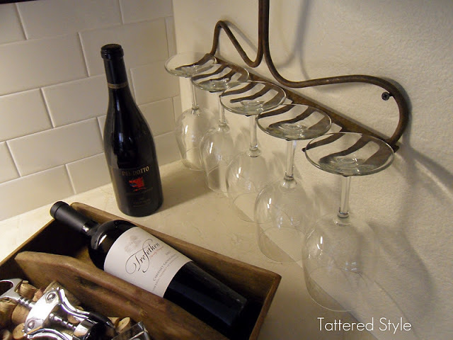 Turn a broken rake into a wineglass holder.