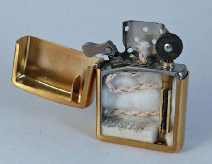 The inside of zippo lighter by cutting it in half.