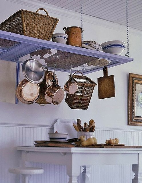 Turn a broken screen door into a pot rack for your kitchen.