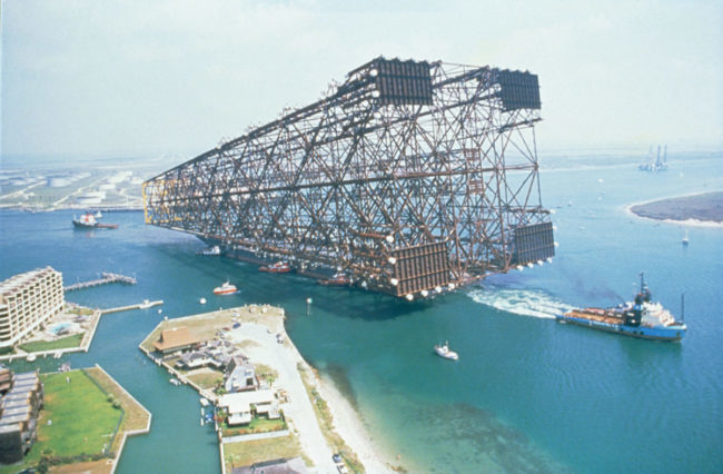 Oil platform being towed out to sea.