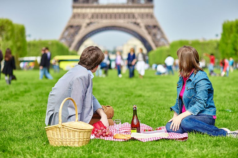 Having A Picnic Near The Eiffel Tower In Paris, France