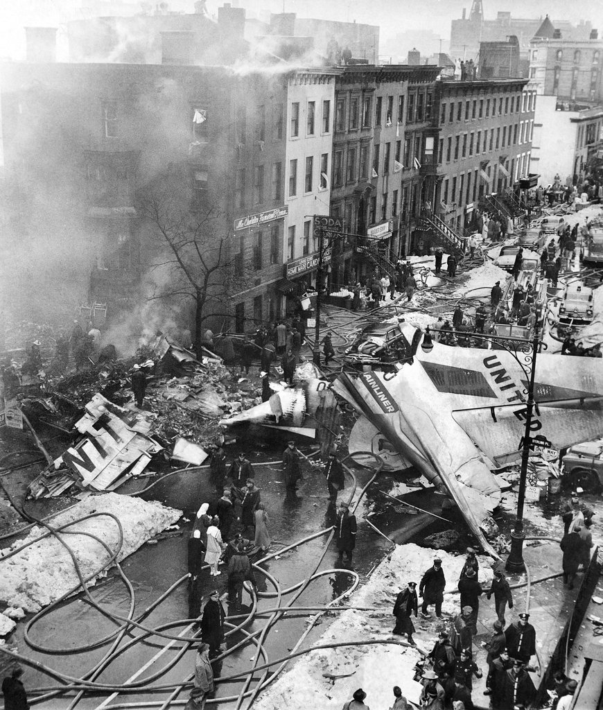 The wreckage of an airplane, post-crash into a Brooklyn neighborhood in 1960.