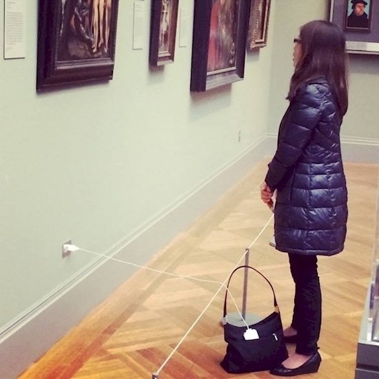 Meanwhile, here's a woman ruining everyone's museum experience.