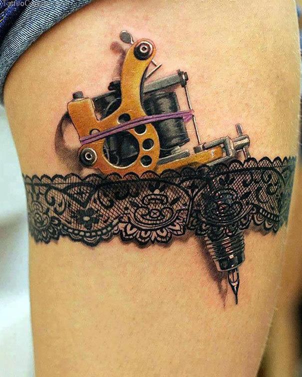 A tattoo gun behind a garter.
