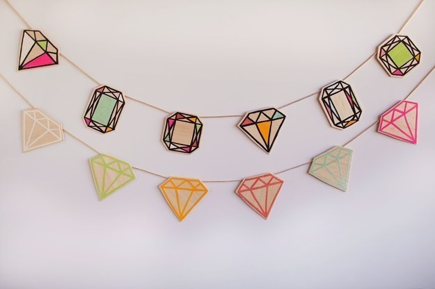 Create some bling to one of your plain walls by creating a gemstone garland.