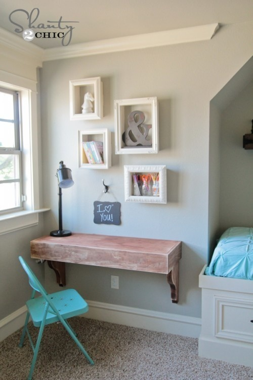 Attach frames to your floating shelves to recreate this cute look.
