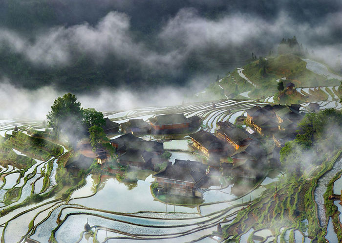 Terraces Village In The Mist, China