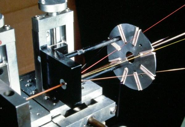 Stranding several fibres into a single cable