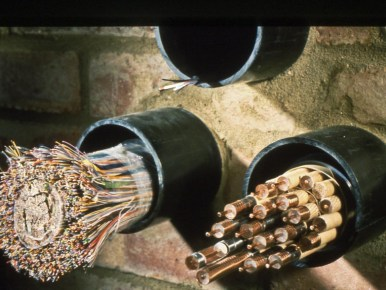 A multi-pair copper cable, a multiple co-ax cable, and a fibre cable