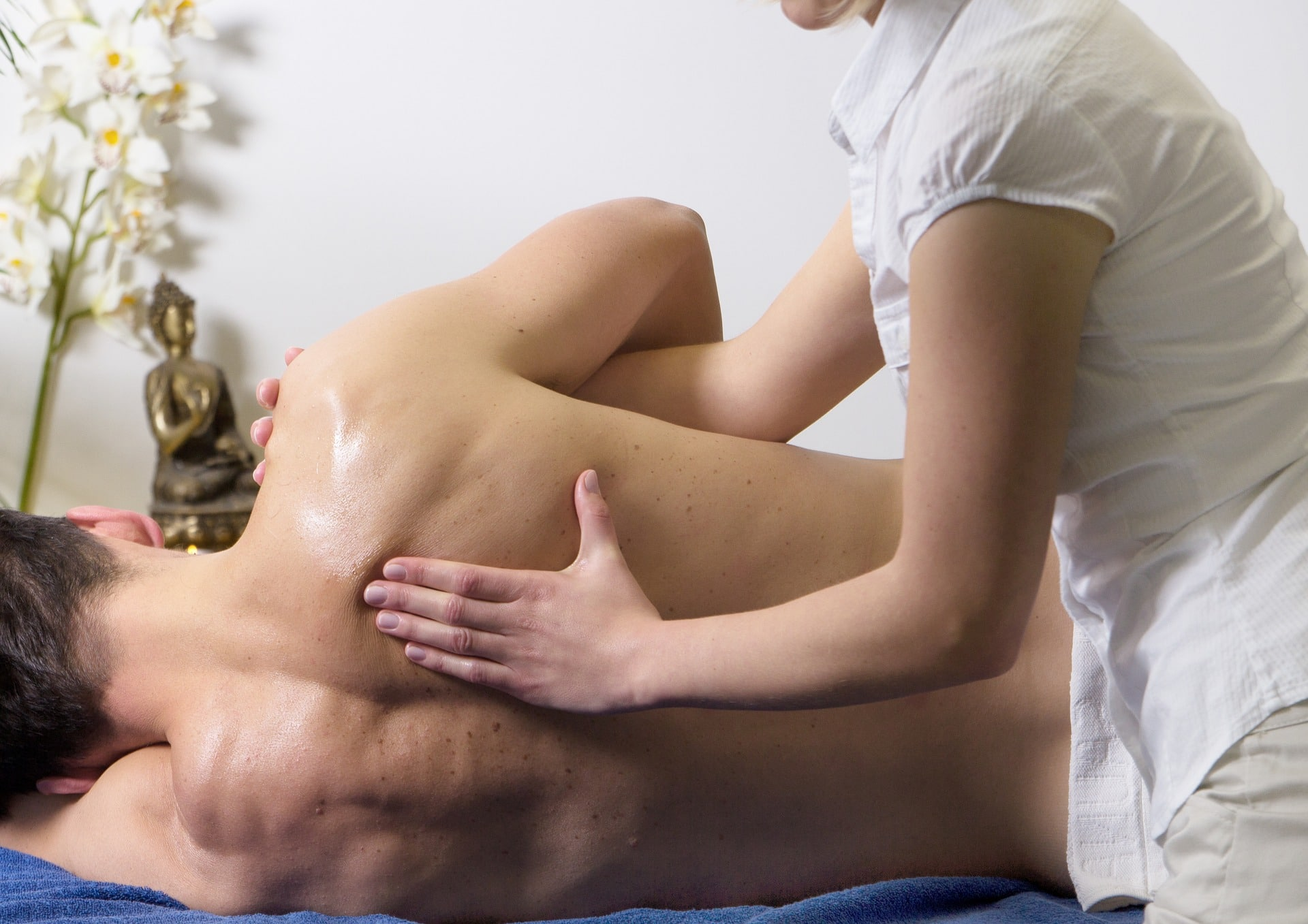 physical therapist treating back pain with manual therapy