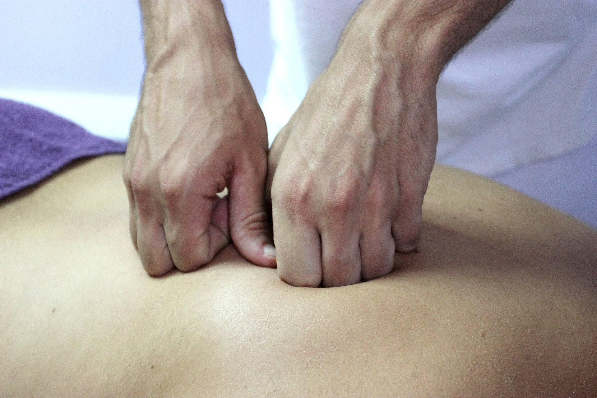 physical therapist treating lower back pain with manual therapy