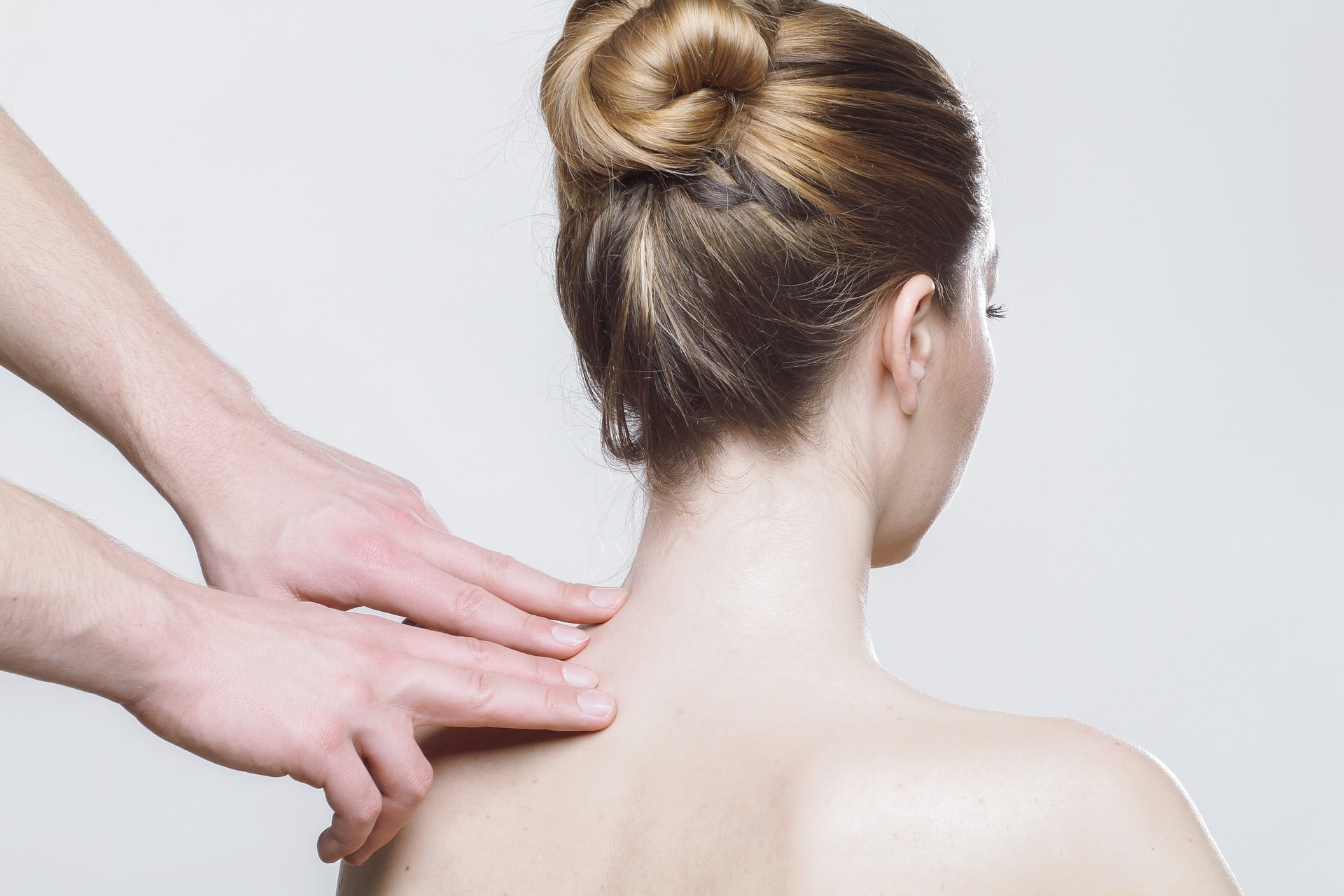 physical therapist treating shoulder pain