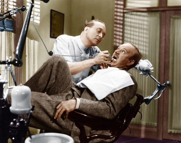 Old photo of dentist and scared patients on dental website