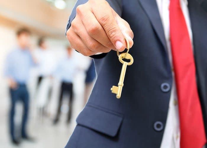 Man handing over the golden key