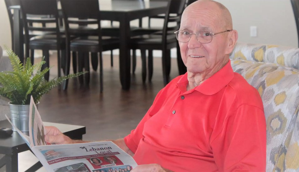 Joe sitting in living room area at Optimized Senior Living