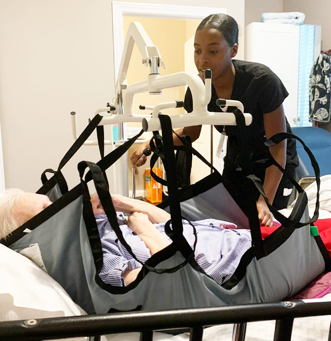 Nurse Assistant Helping Elder Patient at Optimized Senior Living