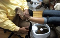 Making a towel boot on the foot.