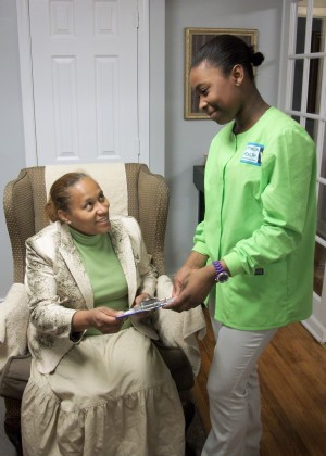 Ayana giving Denise her forms.