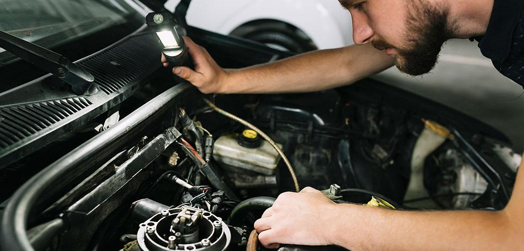 Option1 Auto Man Inspecting Under Hood