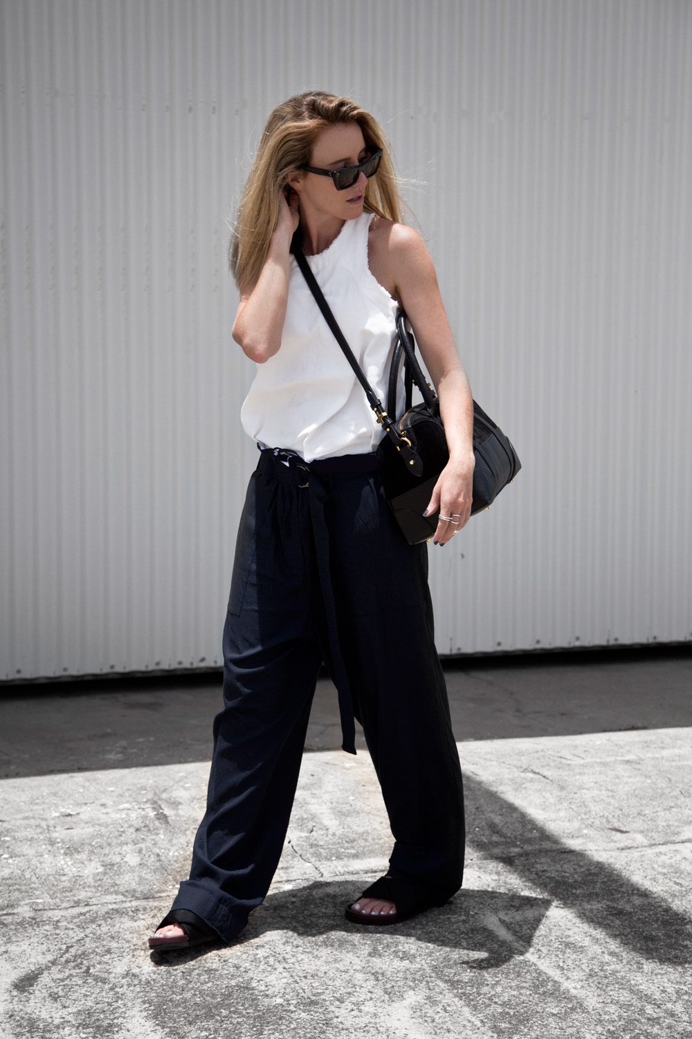 Bassike, white singlet, white top, blue trousers, slouchy trousers, black slides, celine slides, celine sunglasses, dylan kain, bag , duffle bag, outfit, oracle fox