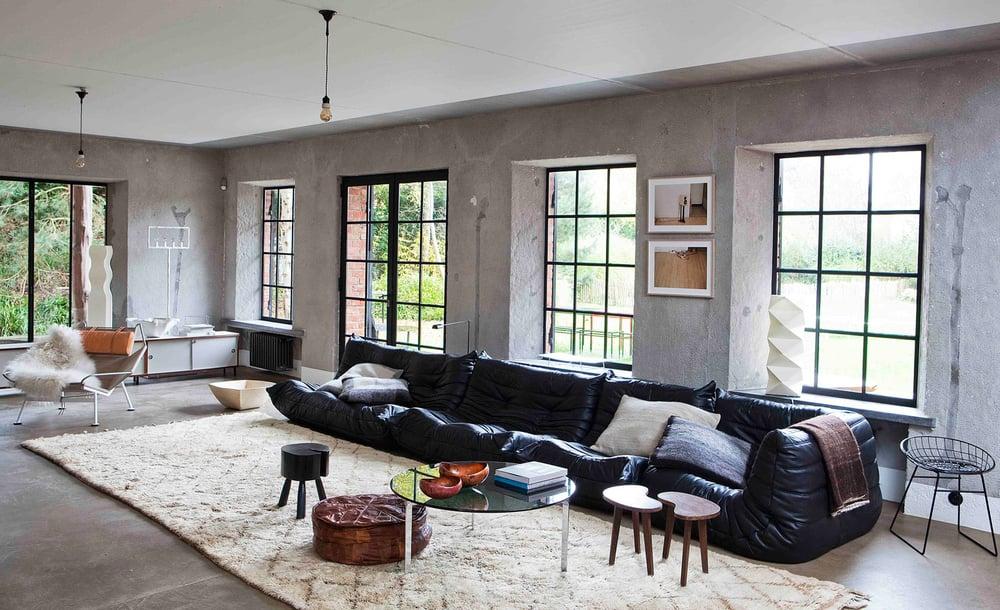 Oracle, Fox, Sunday, Sanctuary, Extracurricular, Bea, Members, Hotel, Belgium, Industrial, Style, Interior, Designer, White, Concrete, Living Room, Black Leather Couch