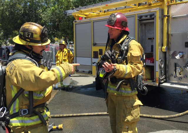 FIREFIGHTERS with the thermal imaging camera used to find the origins of the fire that ravaged a McDonald's eatery in Garden Grove Thursday afternoon (GGFD photo).