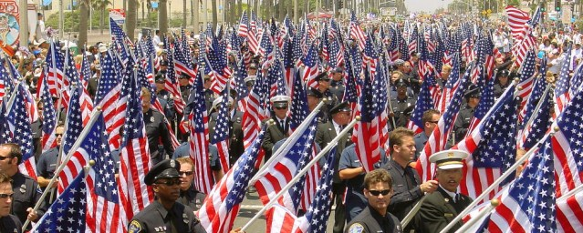 MANY STAR-SPANGLED BANNERS in the July 4th parade in Huntington Beach.