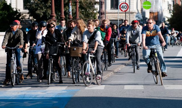 CYCLISTS at a red light in Copenhagen, a city renowned for its wide use of bicycles for transportation (Wikipedia photo).