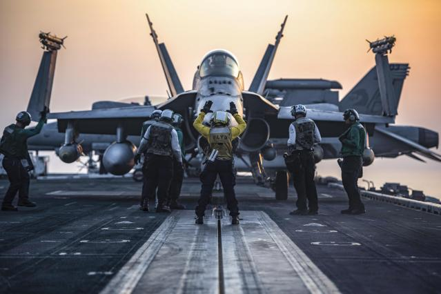 AN F/A-18C Hornet taxis onto the catapult on the flight deck of the aircraft carrier USS Dwight D. Eisenhower in the Arabian Gulf, July 31, 2016. The Eisenhower is supporting Operation Inherent Resolve, maritime security operations and theater security cooperation efforts in the U.S. 5th Fleet area of operations. (Navy photo by Petty Officer 3rd Class J. Alexander Delgado.)