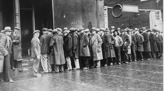 TODAY'S FORGOTTEN MAN may have a job (unlike these men in a soup kitchen line in Chicago in 1931) but it doesn't pay well or have a bright future (National Archives photo).