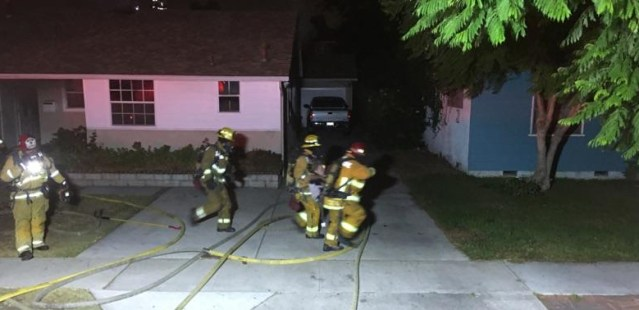 FIREFIGHTERS battle a blaze on Woodland Street in Garden Grove early Thursday morning (GGPD photo).