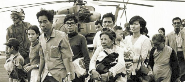 """VIETNAMESE refugees aboard a U.S. Navy ship in the evacuations during """"Black April."""" (Wikipedia photo)."""