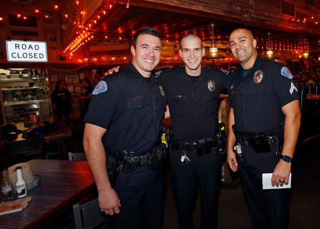 GARDEN GROVE officers, Jeremy Morse, Michael Gerdin and Nick Jensen were part of the team that waited on tables to raise money for the Special Olympics. Photo by Christine Cotter