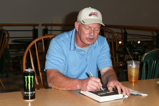"LENNY DYKSTRA signs copies of his book, ""House of Nails."" (Debby Wong/Shutterstock.com)."