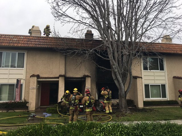 FIREFIGHTERS at a Huntington Beach condo complex Saturday afternoon (HBFD photo).