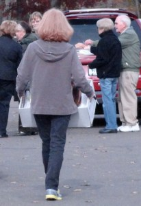 A woman carries a large box of paperwork to be shredded at High Plains on Saturday.